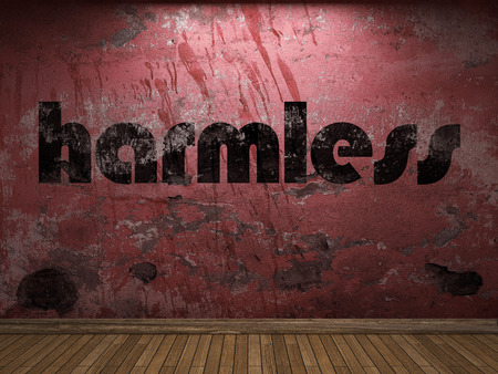 harmless: harmless word on red wall Stock Photo