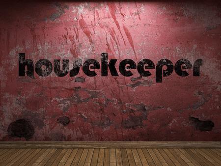 housekeeper: palabra ama de llaves en la pared roja Foto de archivo
