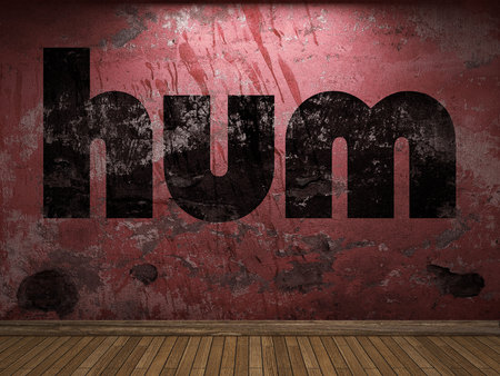 hum: hum word on red wall Stock Photo