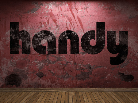 handy: handy word on red wall