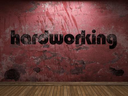 hardworking: hardworking word on red wall