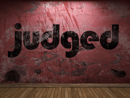 judged: judged word on red wall