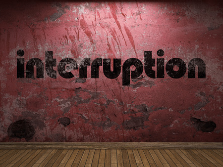 interruption: interruption word on red wall