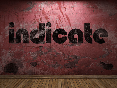 indicate: indicate word on red wall Stock Photo