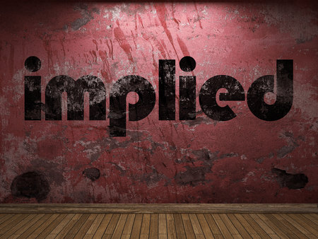 implied: implied word on red wall Stock Photo