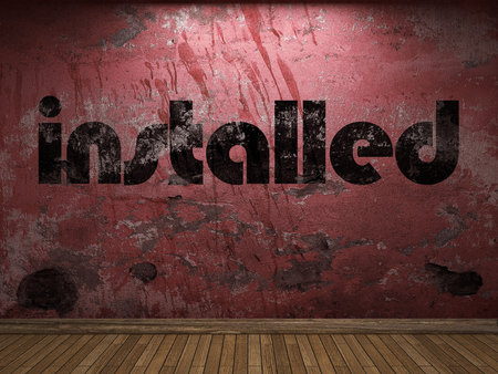 installed: installed word on red wall Stock Photo