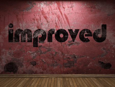 improved: improved word on red wall Stock Photo