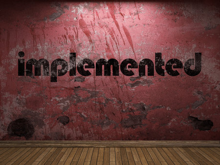 implemented: implemented word on red wall