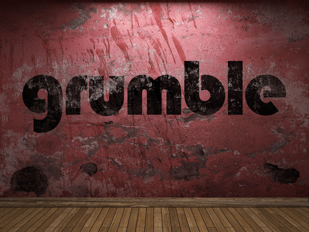grumble word on red wall Stock Photo