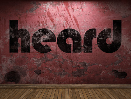 heard: heard word on red wall