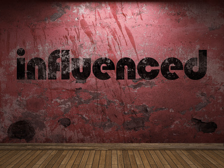 influenced: influenced word on red wall
