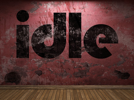 idle: idle word on red wall