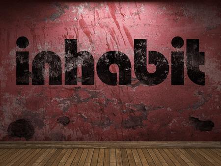 inhabit: inhabit word on red wall Stock Photo
