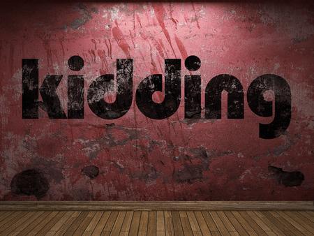 kidding: kidding word on red wall