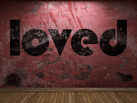 loved: loved word on red wall Stock Photo