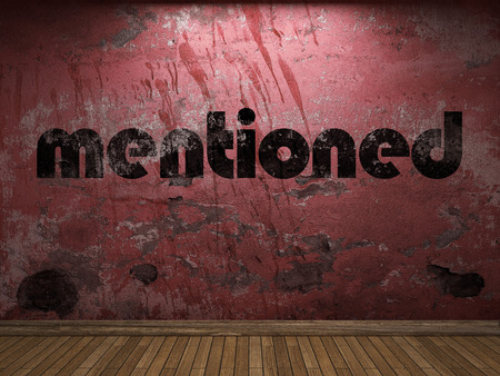 mentioned: mentioned word on red wall Stock Photo