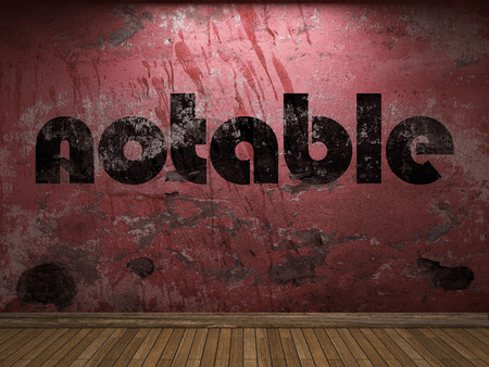 notable: notable word on red wall Stock Photo