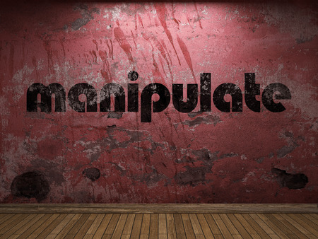 manipulate: manipulate word on red wall Stock Photo