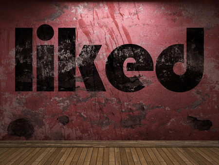 liked: liked word on red wall Stock Photo