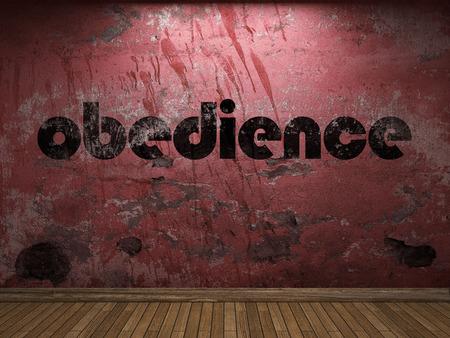 obediencia: palabra obediencia en la pared roja