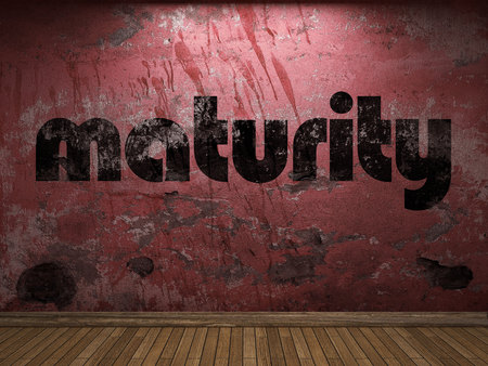 maturity: maturity word on red wall Stock Photo