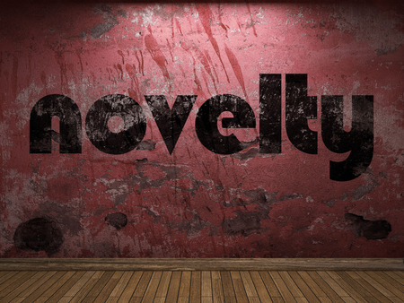 the novelty: novelty word on red wall Stock Photo