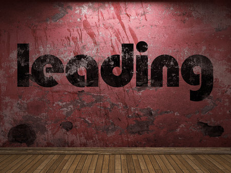 leading: leading word on red wall Stock Photo