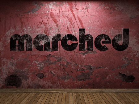 marched: marched word on red wall Stock Photo