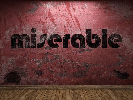 miserable: miserable word on red wall Stock Photo