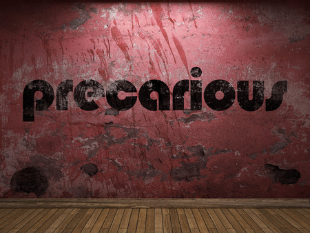 precarious: precarious word on red wall Stock Photo