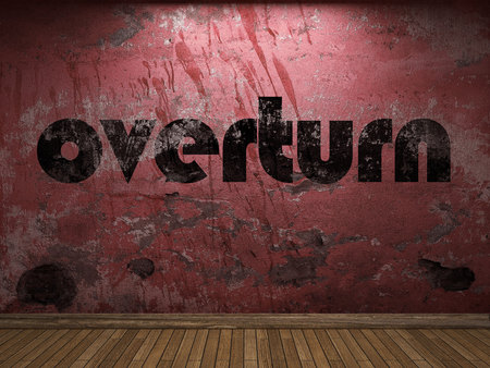 overturn: overturn word on red wall Stock Photo