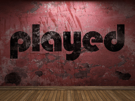 played: played word on red wall Stock Photo