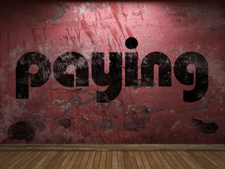 paying: paying word on red wall