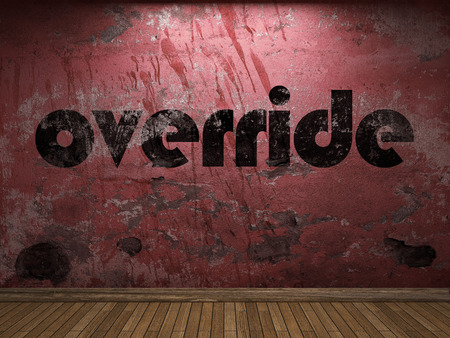 override: override word on red wall Stock Photo