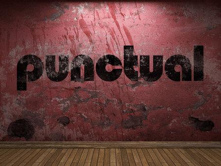punctual: palabra puntual en la pared roja