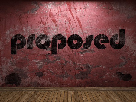 proposed: proposed word on red wall Stock Photo