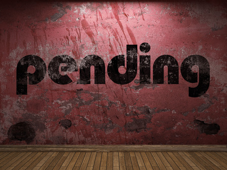 pending: pending word on red wall Stock Photo