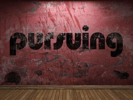 pursuing: pursuing word on red wall Stock Photo