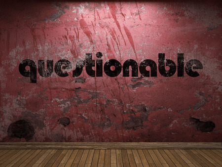 questionable: questionable word on red wall Stock Photo