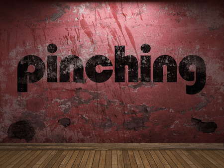 pinching: pinching word on red wall