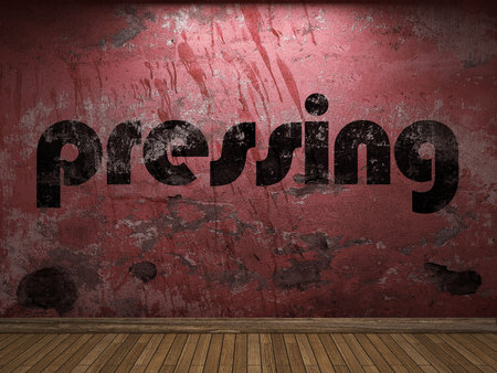 pressing: pressing word on red wall