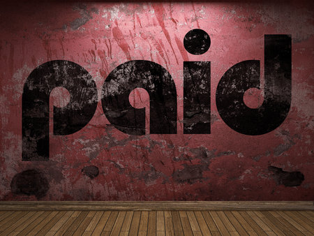 paid: paid word on red wall Stock Photo