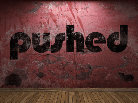pushed: pushed word on red wall