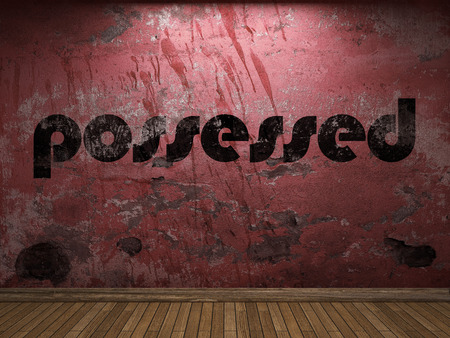 possessed: possessed word on red wall Stock Photo