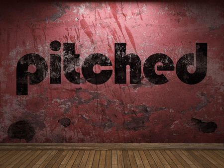 pitched: pitched word on red wall