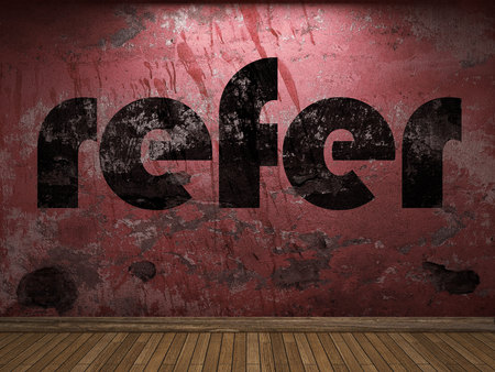 refer: refer word on red wall Stock Photo