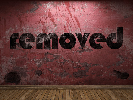 removed: removed word on red wall Stock Photo