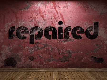 repaired: repaired word on red wall Stock Photo