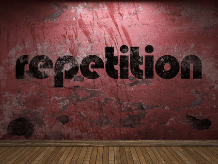 repetition: repetition word on red wall Stock Photo