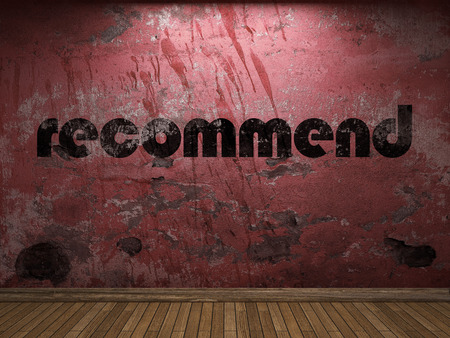 recommend: recommend word on red wall Stock Photo